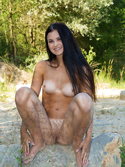 Celeste bares her slender, tanned body outdoors.