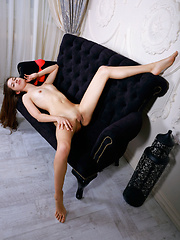 Dominika Leal strips her red lingerie on the sofa baring her delectable cunt.