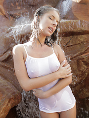 Tempting Nubile Presley Hart gets soaking wet in the waterfall