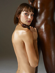 Interracial couple of oiled man and girl