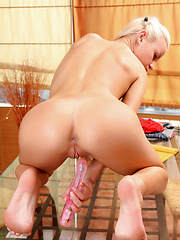 Horny Nubile babe shoves a vibrator into her wet pussy