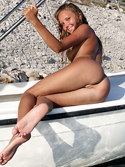 Mango noticeable tan lines traces her humble breasts with puffy nipples, and smooth, shaven pussy, leaving the rest of her toned body luxuriously tanned to perfection.