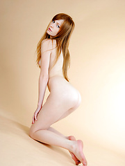Jo soft and supple body is on display with subtly erotic poses and a sultry look on her pretty face.
