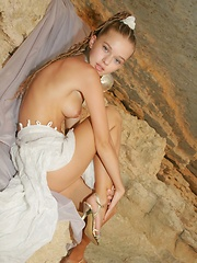Petite cutie with angelic face and nubile body.