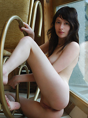 Dark hair and angel eyes on a rocking chair made for one.