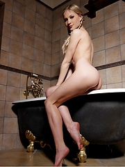 Candice B poses in a bathroom