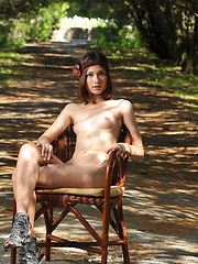 Marvelous dark haired hottie taking off clothes and spreading legs outdoor in the park.