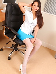 Leggy Chelsea strips on the desk in blue mini skirt