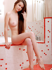 Emily Bloom plays naked in the bath tub