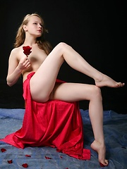 Blonde beauty Mia C in flowy red skirt accentuating her long, porcelain-smooth legs and cute butt