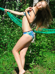 Adorable and playful with a warm,   endearing smile, Bridgit is a delight   to watch, stripping and flaunting her   gorgeous slender body amidst the lush   greeneries of the outdoors.