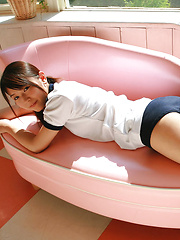 Noriko Kijima Asian in sports equipment is playful in the house