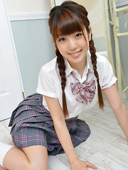 Mizuho Shiraishi Asian with sexy pigtails shows ass under skirt