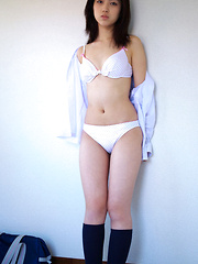 Azusa Togashi Asian undresses uniform to show behind in panty
