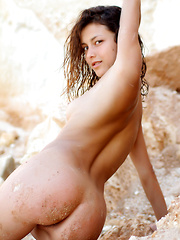 Divina A\'s slender body, an undeniably pretty face, and sultry allure is a pleasing break from the rugged rocks and desolate terrain on her background.