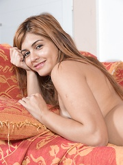 Olivia arrives home to strip naked on her sofa