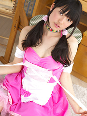 Tomoe Yamanaka Asian in pink maid uniform plays with teddy bear